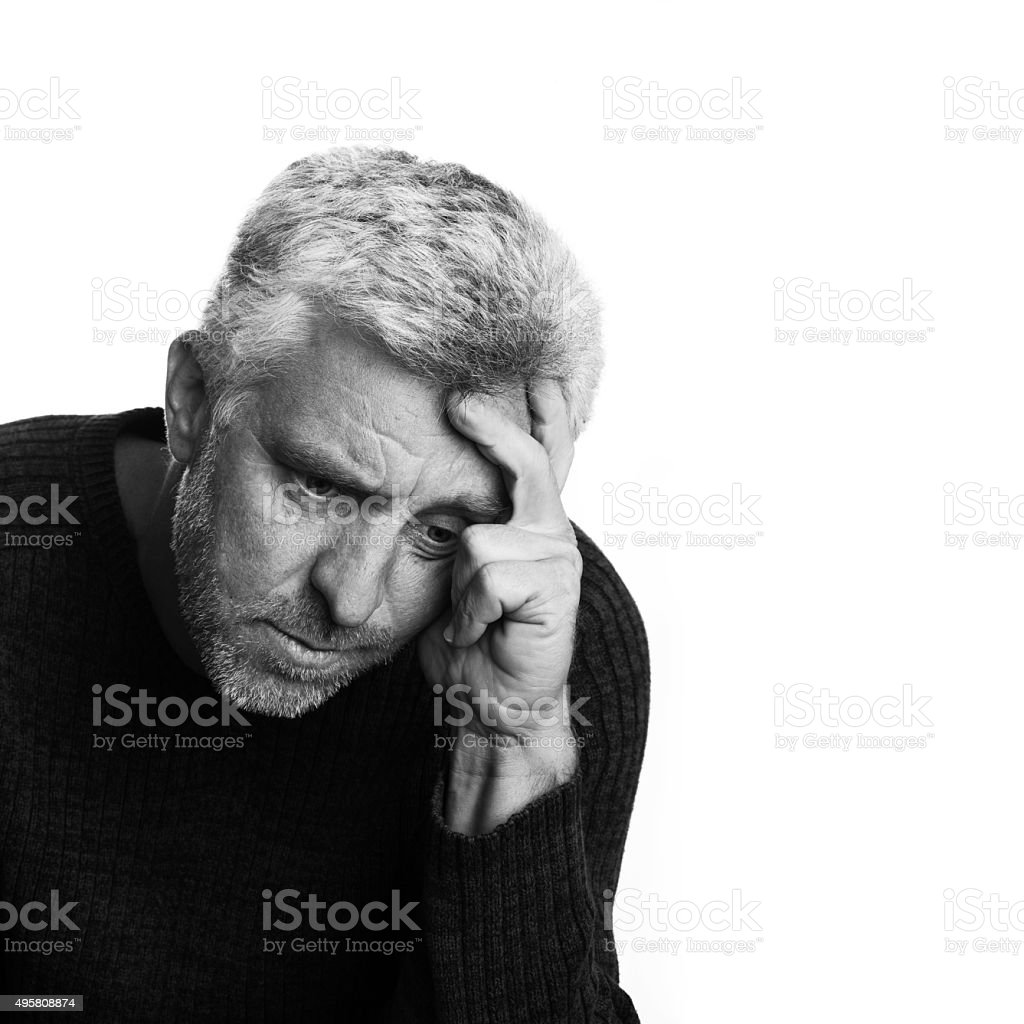 elderly man lost in depression thought stock photo