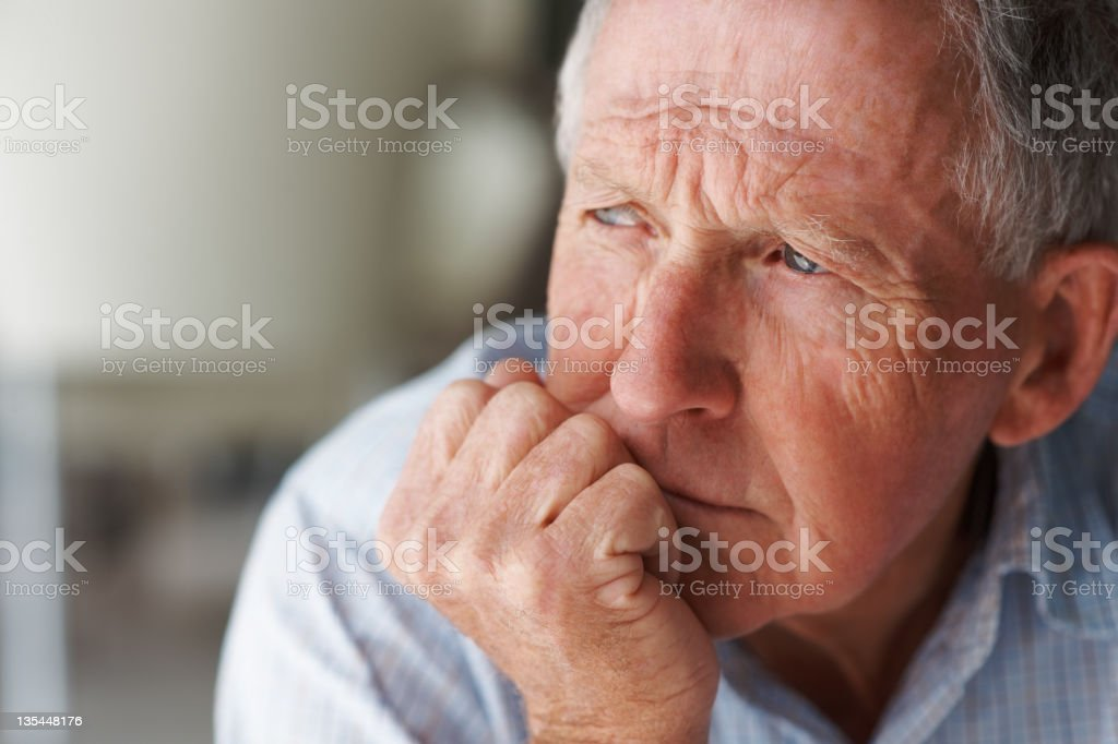 Elderly man lost in thought royalty-free stock photo