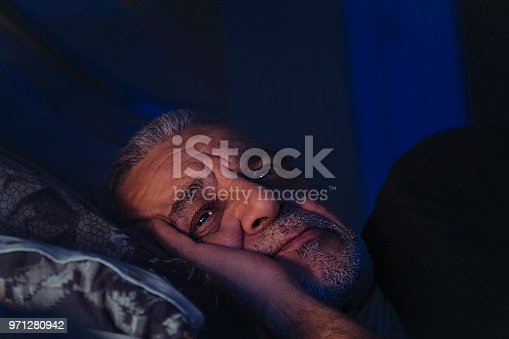 istock Elderly man lost in thought 971280942