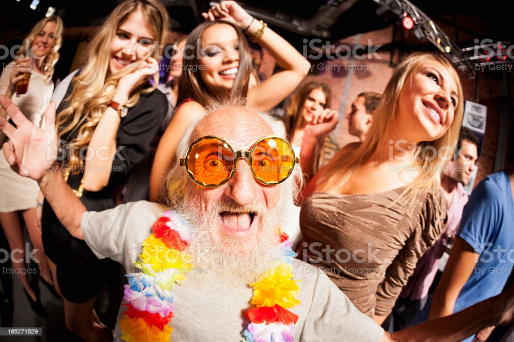 Elderly man pictured through fisheye lens at party stock photo