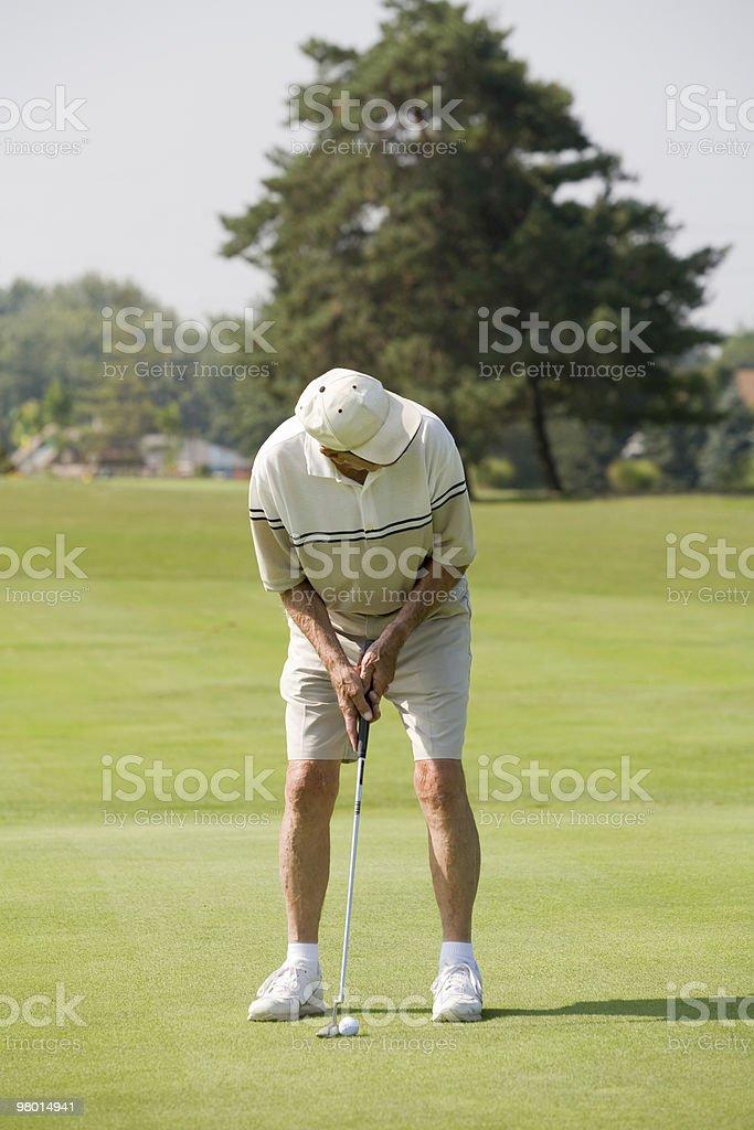 Elderly Man Playing Golf royalty-free stock photo