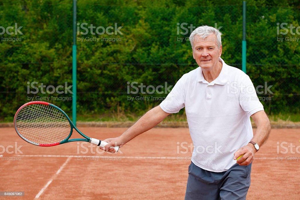 Free Clip Art of Elderly Man Playing Tennis