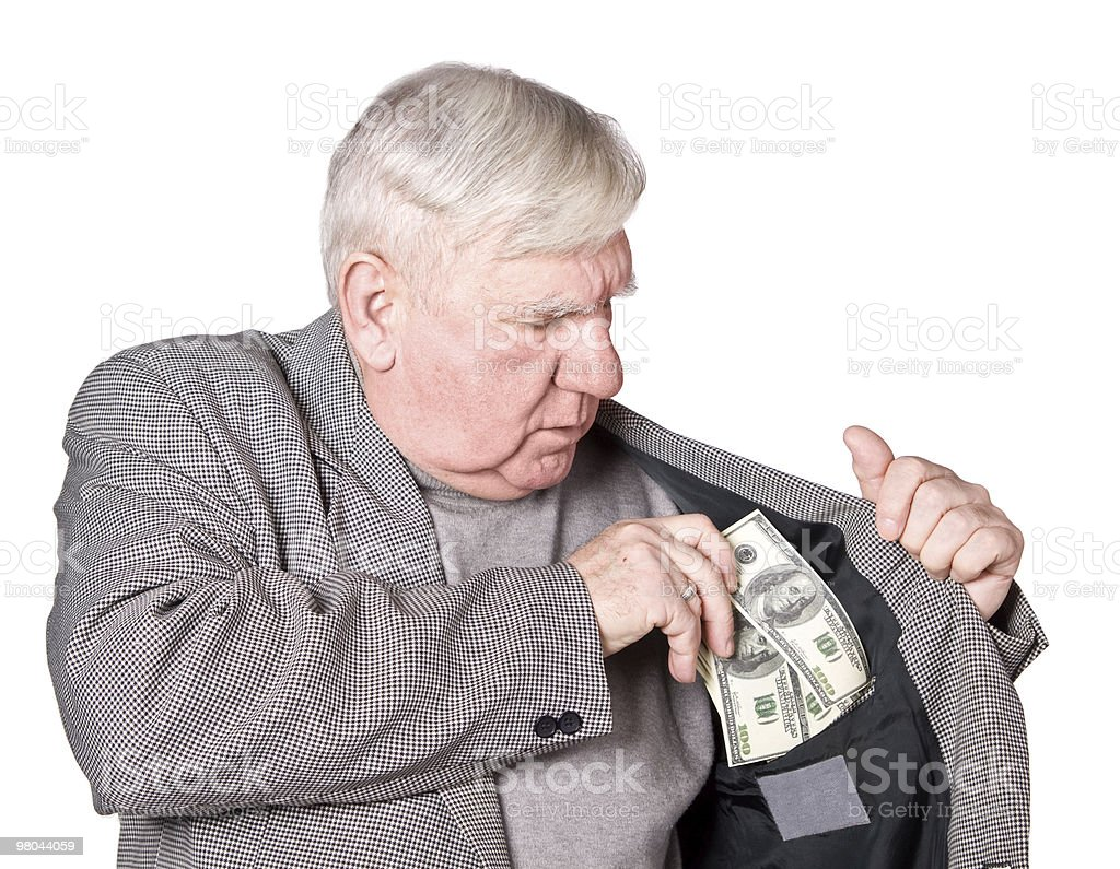Elderly man putting money in jacket inside pocket royalty-free stock photo