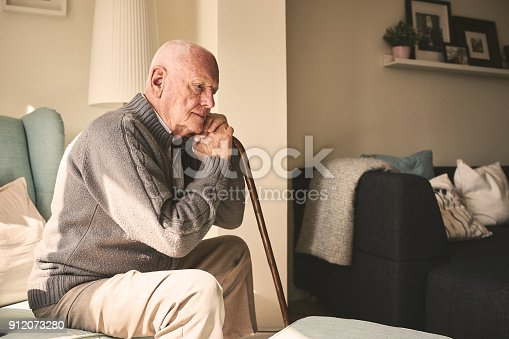 istock Elderly man sitting alone at home 912073280