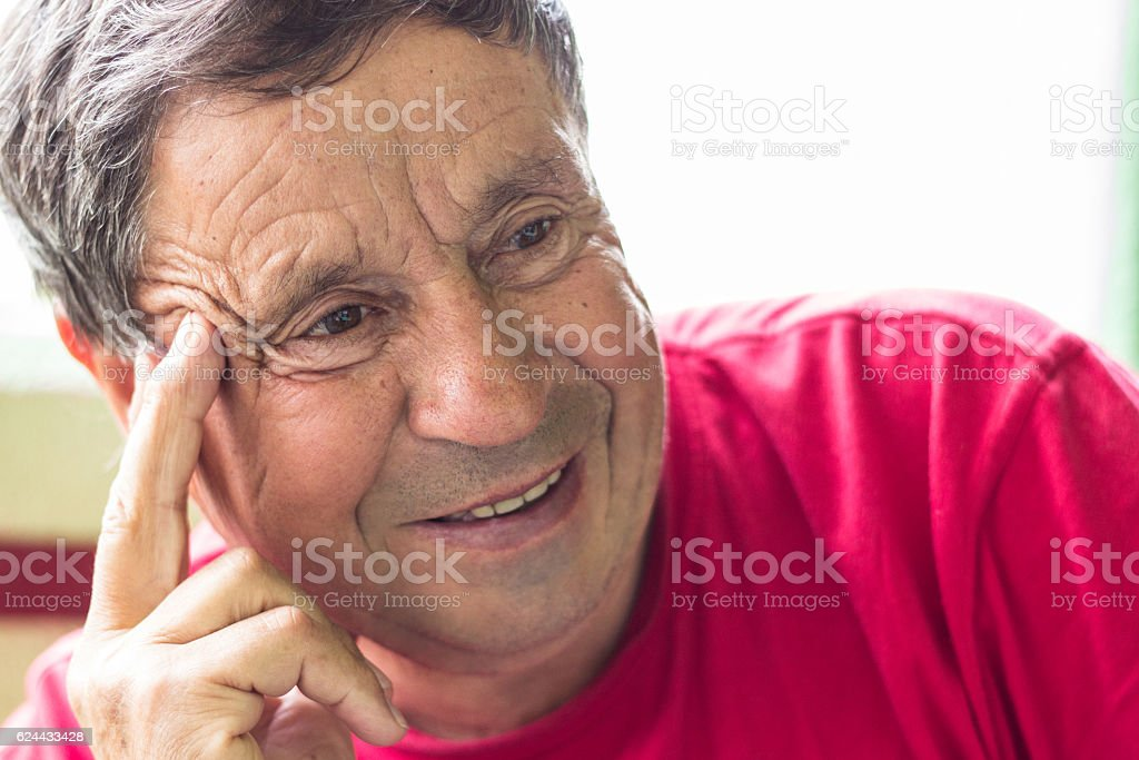Elderly man smiling stock photo