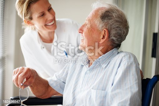 istock Elderly man speaking to a nurse 152498547