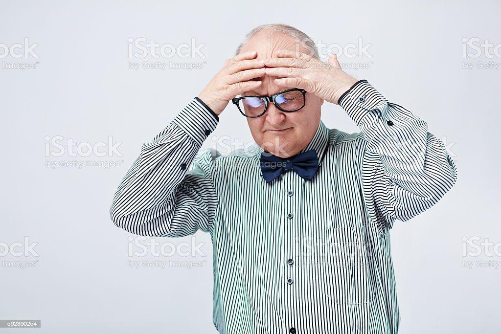 Elderly Man Suffering from Headache Lizenzfreies stock-foto