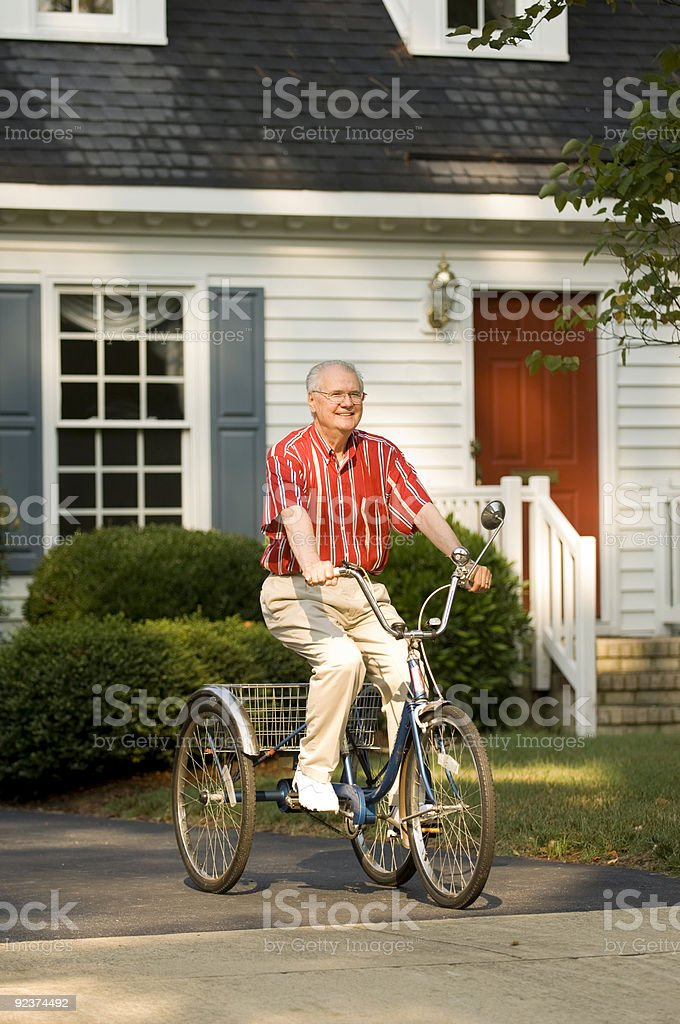 Elderly Man Taking A Ride On Bike royalty-free stock photo