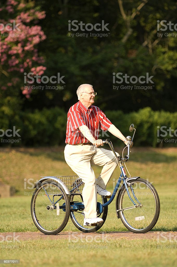 Elderly Man Taking A Ride On Bike royalty-free stock photo