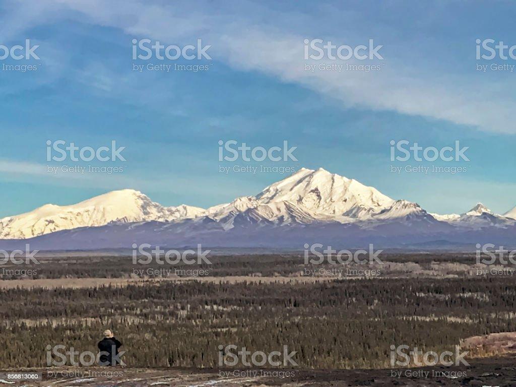 Elderly man taking picture - Alaska stock photo