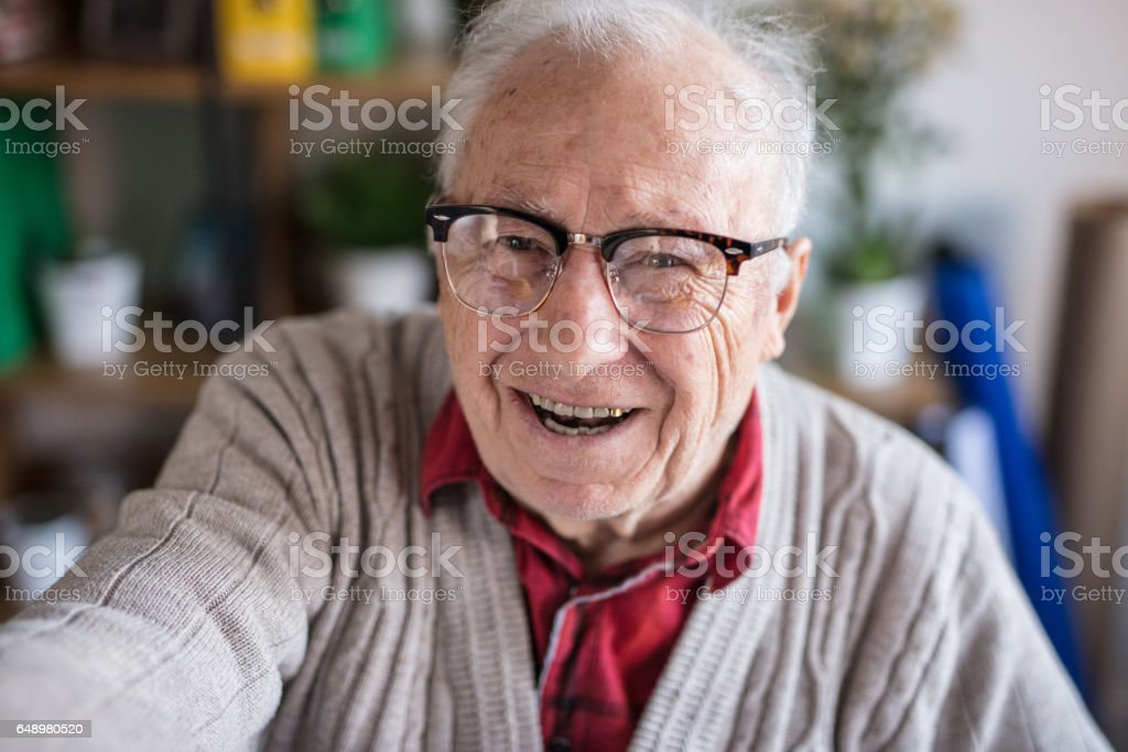 Elderly man taking selfie stock photo