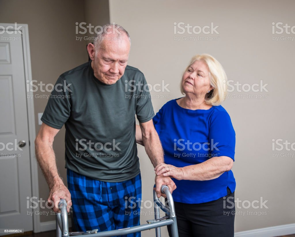 Elderly Man using a Walker stock photo