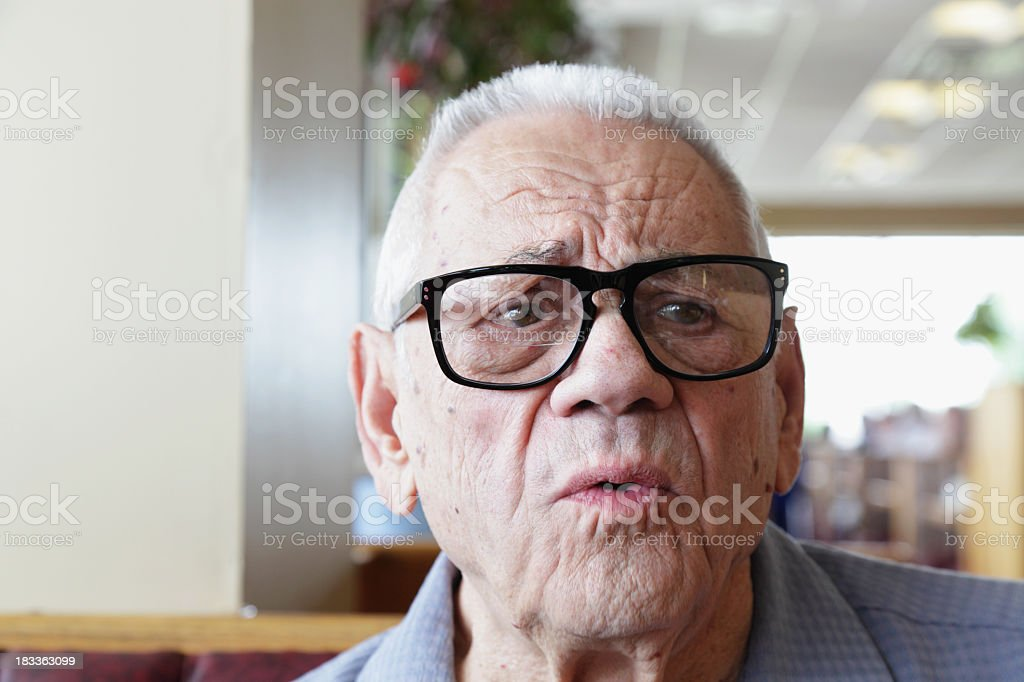 Elderly Man Waiting Impatiently for Lunch royalty-free stock photo