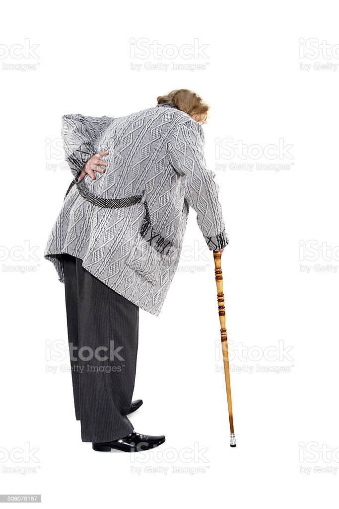 Elderly man walking with stick stock photo
