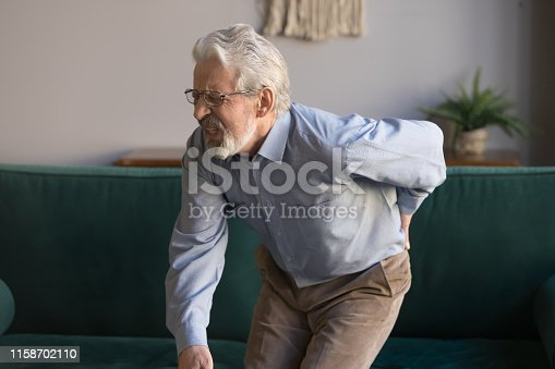 821012164istockphoto Elderly man writhes in pain suffers from low back strain 1158702110