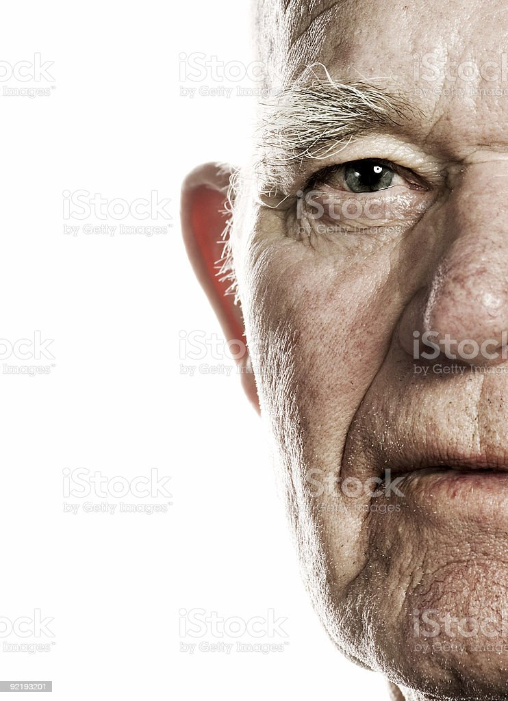 Elderly man's face over white background stock photo