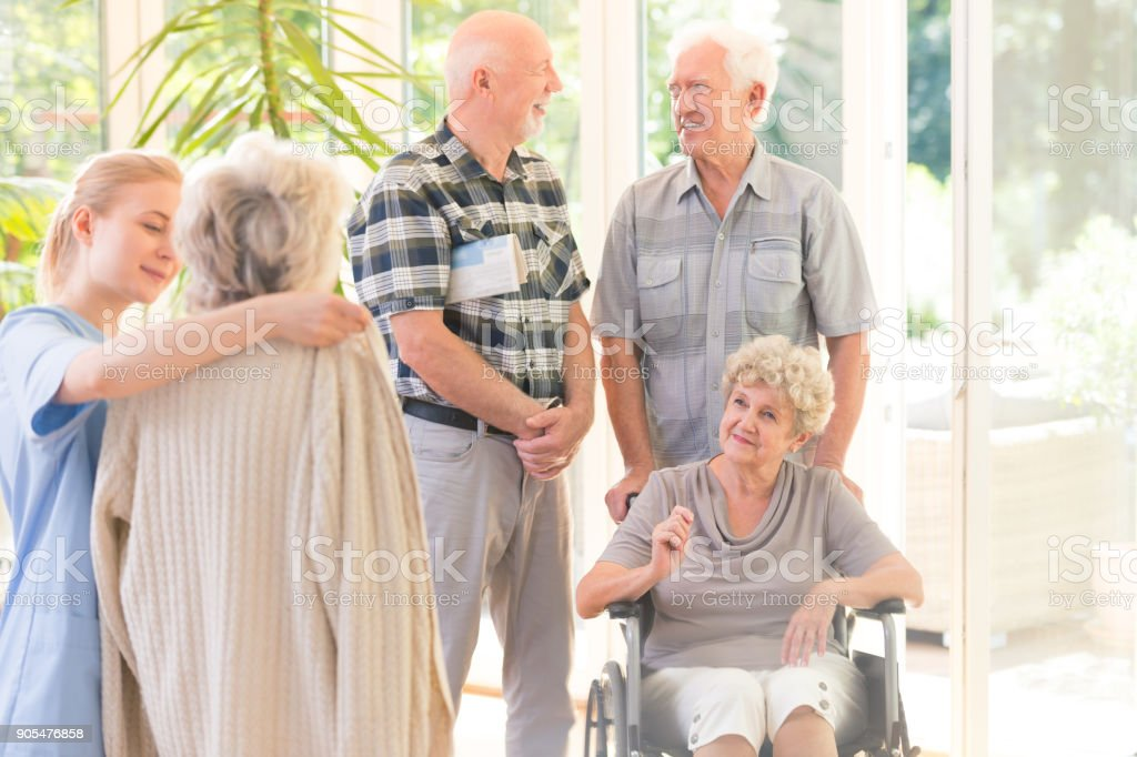 Elderly men talking together stock photo