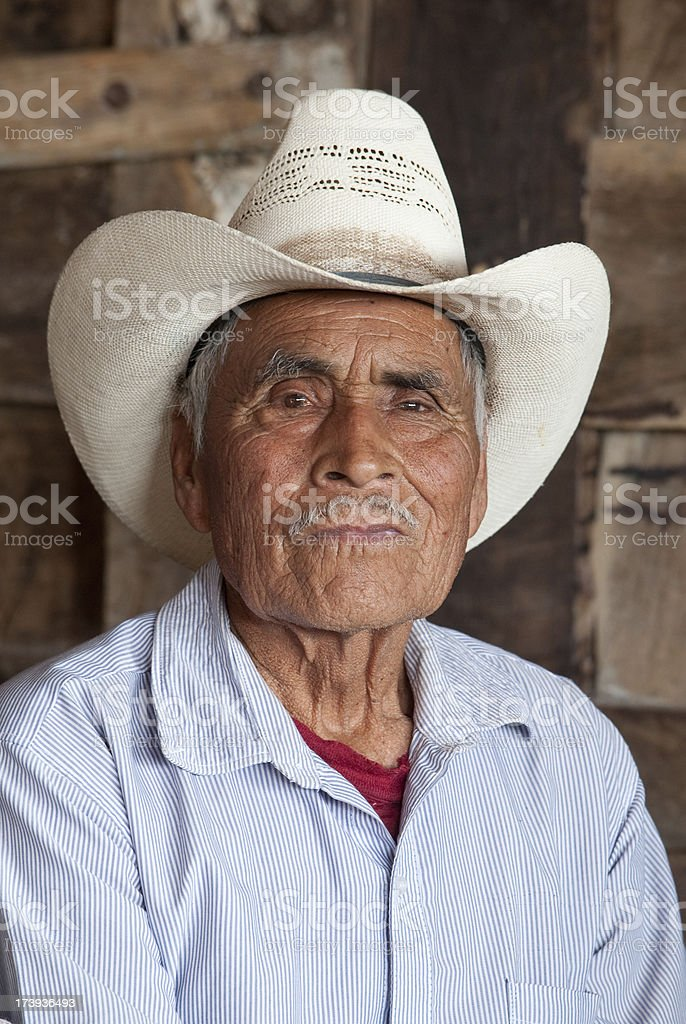 Elderly Mexican with white hat royalty-free stock photo
