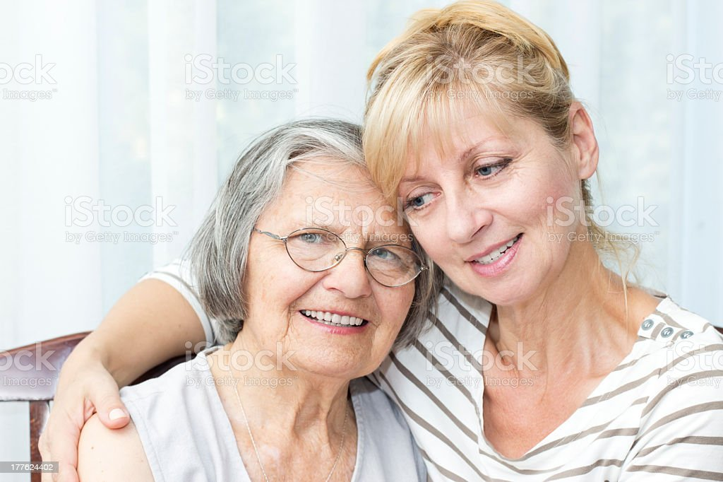 Elderly mother with her daughter stock photo