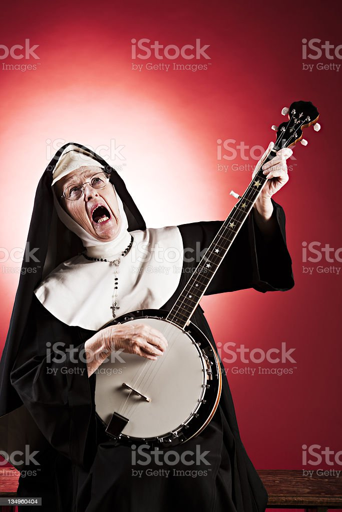 Elderly nun gets her groove on to banjo backing! stock photo