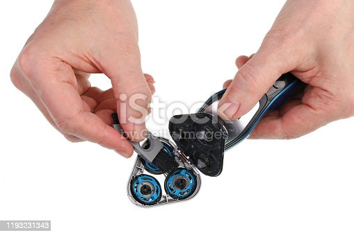 626808632istockphoto Elderly old man cleaning of electrical hairshaver  with brush   isolated 1193231343