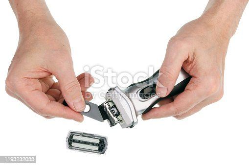 626808632istockphoto Elderly old man cleaning of silver electrical vibration hairshaver  with  brush   isolated 1193232033