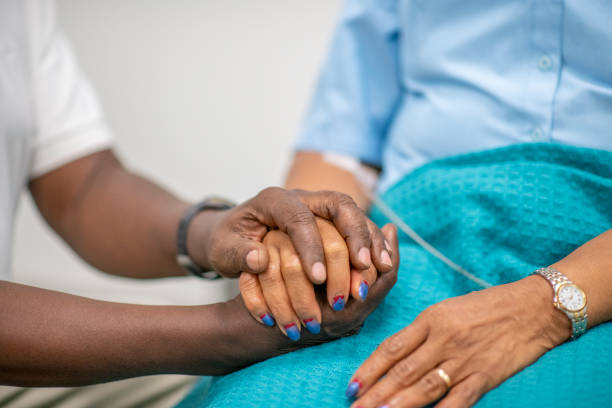 Elderly Patient is Comforted by Medical Personnel stock photo stock photo