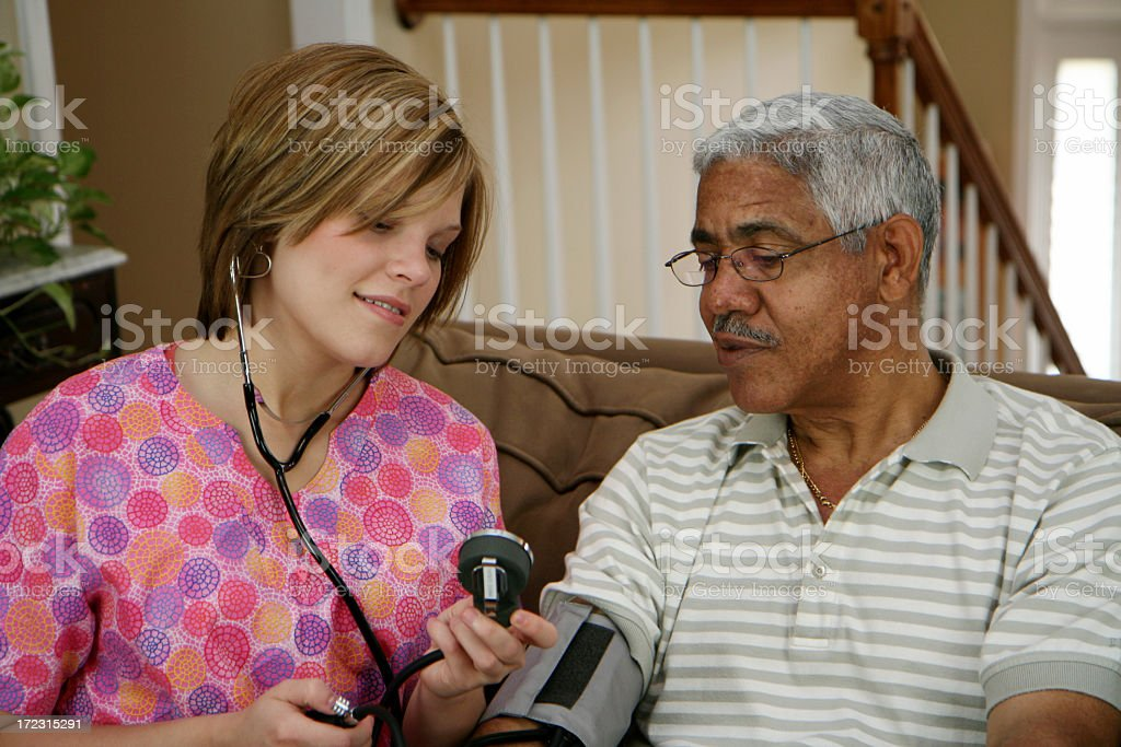 Elderly patient receiving medical care at home royalty-free stock photo