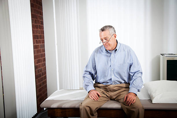 Elderly patient sitting at a doctor's office and waiting stock photo