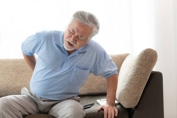 Elderly patients in bed, Asian senior man patients back pain - medical and healthcare concept stock photo