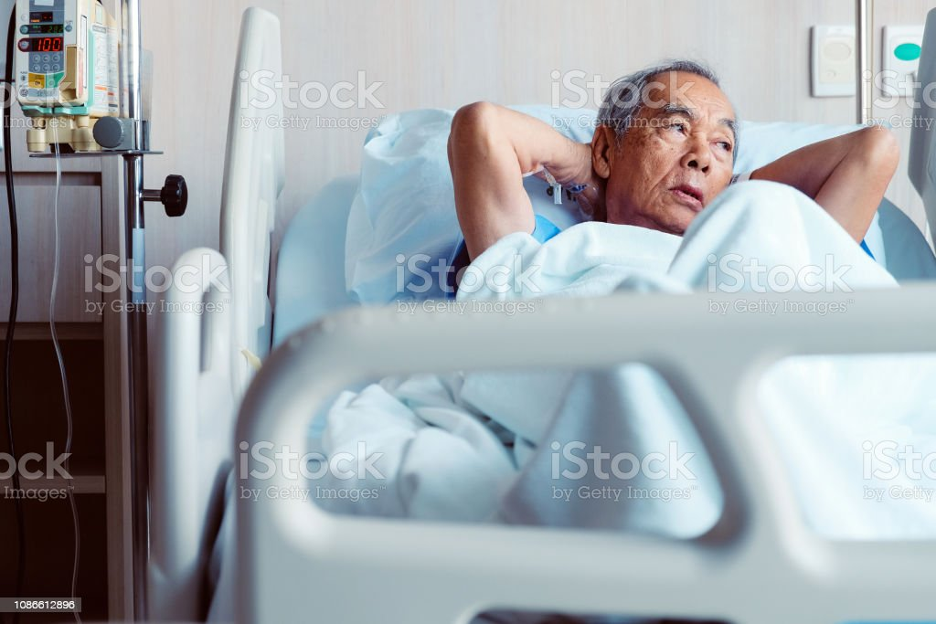 Elderly patients in hospital bed stock photo