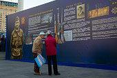 Kiev, Ukraine - October 14, 2018: Elderly people consider historical materials on the Maidan Nezalezhnosti in anniversary of creation of the Ukrainian army