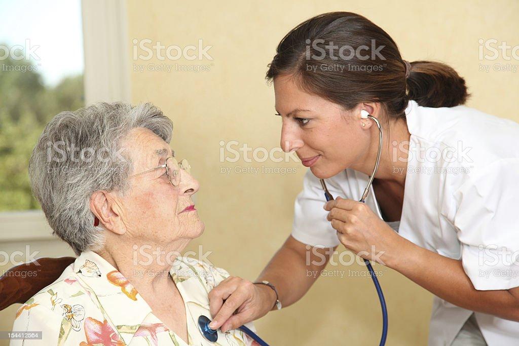 Elderly person with nurse stock photo