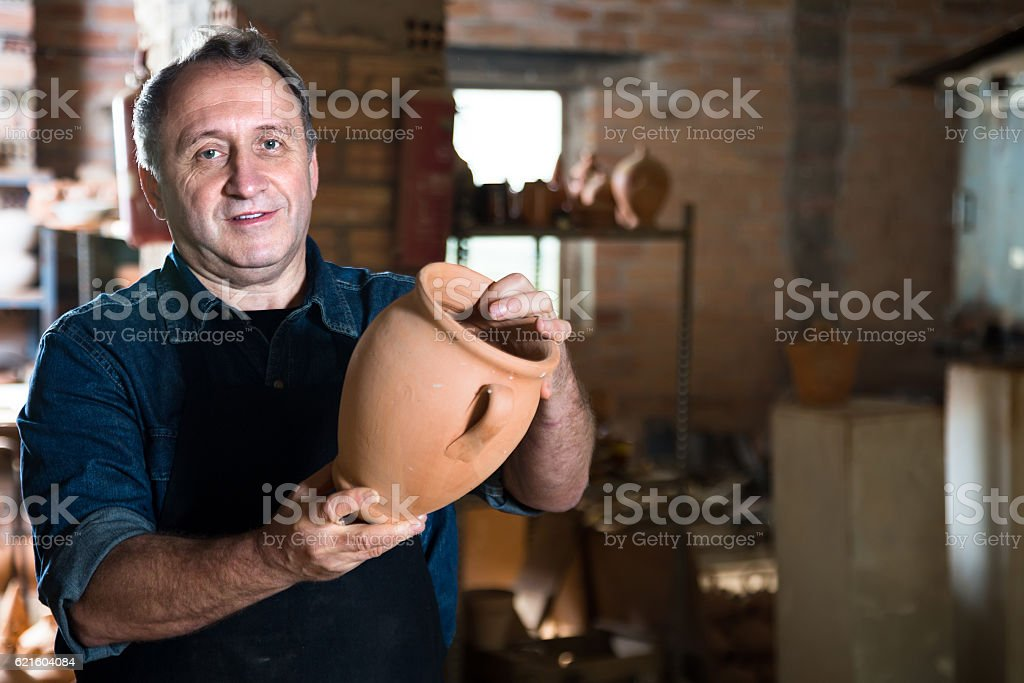 Elderly potter at ceramic workshop stock photo