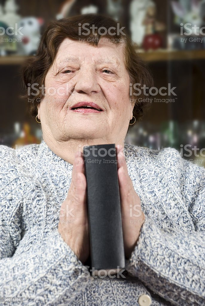Elderly praying and hold a bible royalty-free stock photo