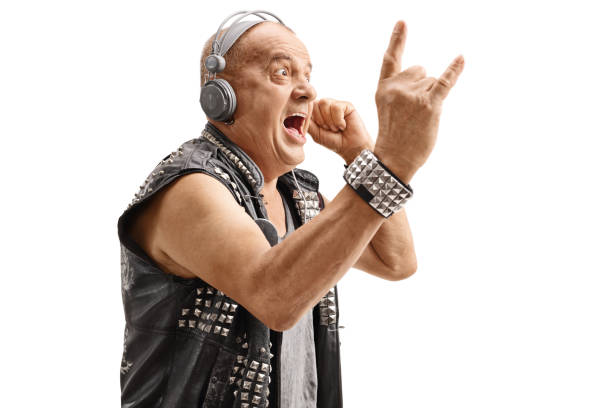 elderly punker listening to music and making rock hand gesture - punk music stock photos and pictures
