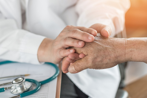 Elderly Senior Adult Patient Having Geriatric Doctor Consulting And Diagnostic Examining On Aging And Mental Health Care In Medical Clinic Office Or Hospital Examination Room Stock Photo - Download Image Now