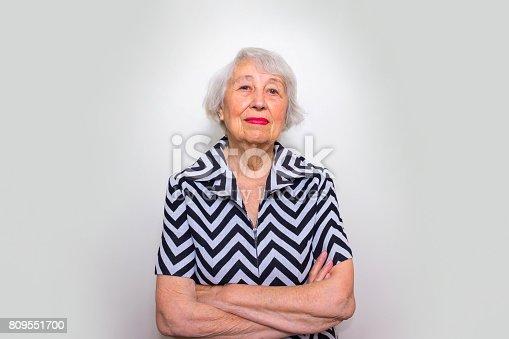 istock Elderly serious woman 809551700