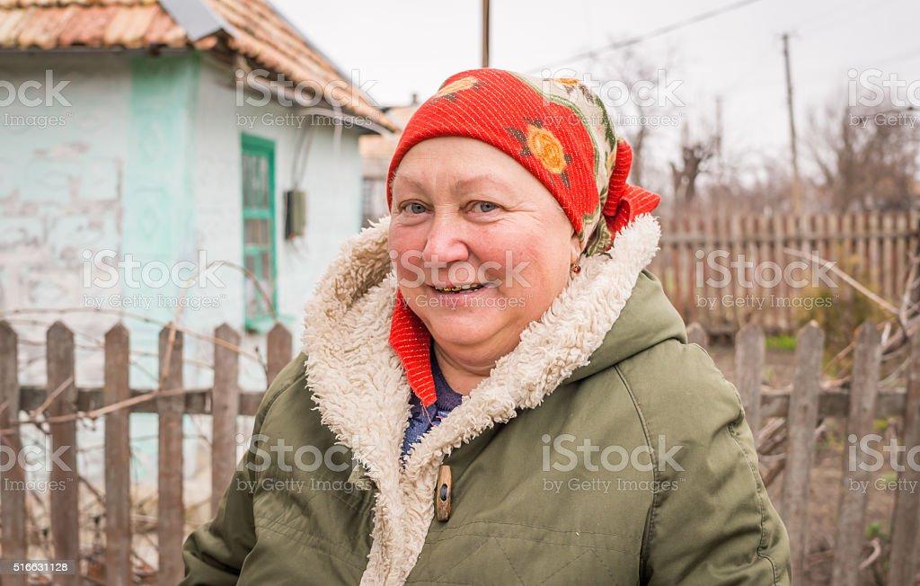 Elderly Slavic woman in the village stock photo