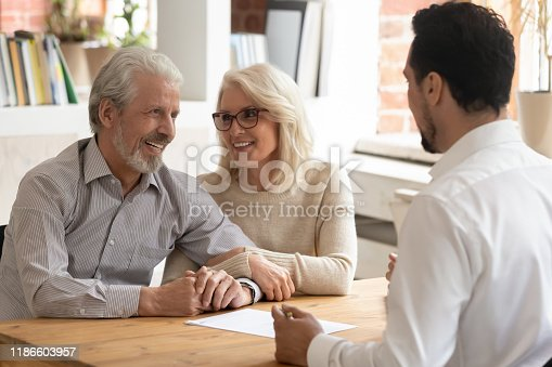 1129638619 istock photo Elderly spouses during meeting with banker or real estate agent 1186603957