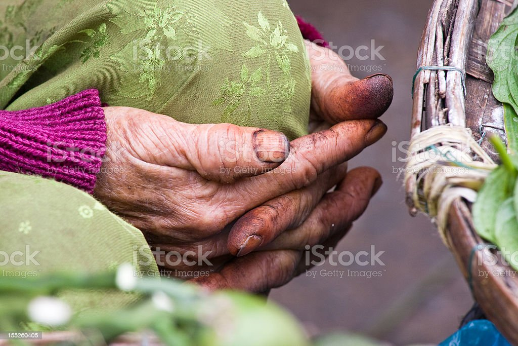 Elderly stained hands stock photo