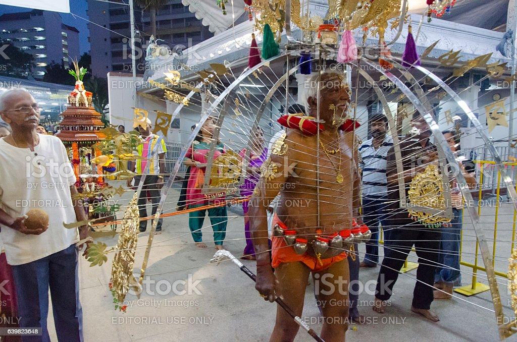 Elderly Thaipusam devotee stock photo