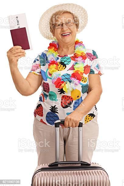 Elderly tourist holding a passport and a suitcase picture id621590136?b=1&k=6&m=621590136&s=612x612&h=kpfpzldbadvqd3nlzsmk0xpdndmvuagkocu9csa1roe=