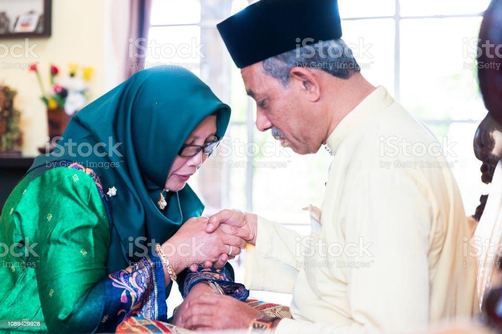 Elderly wife celebrating Hari Raya Aidilfitri stock photo