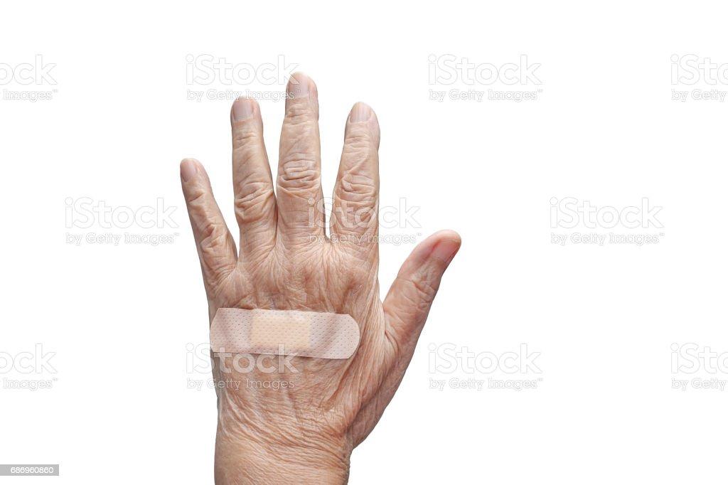 Elderly woman adhesive bandage on her hand stock photo