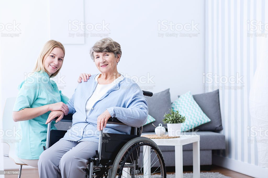 Elderly woman and caregiver stock photo