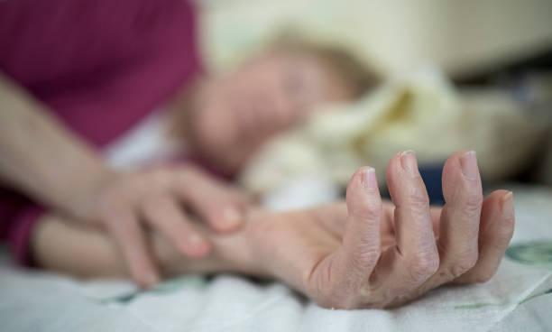 Elderly woman at illness