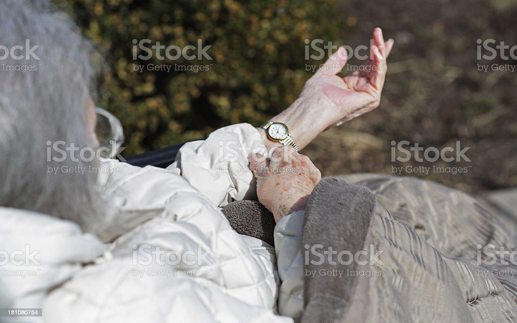Elderly Woman Checking Her Wristwatch royalty-free stock photo