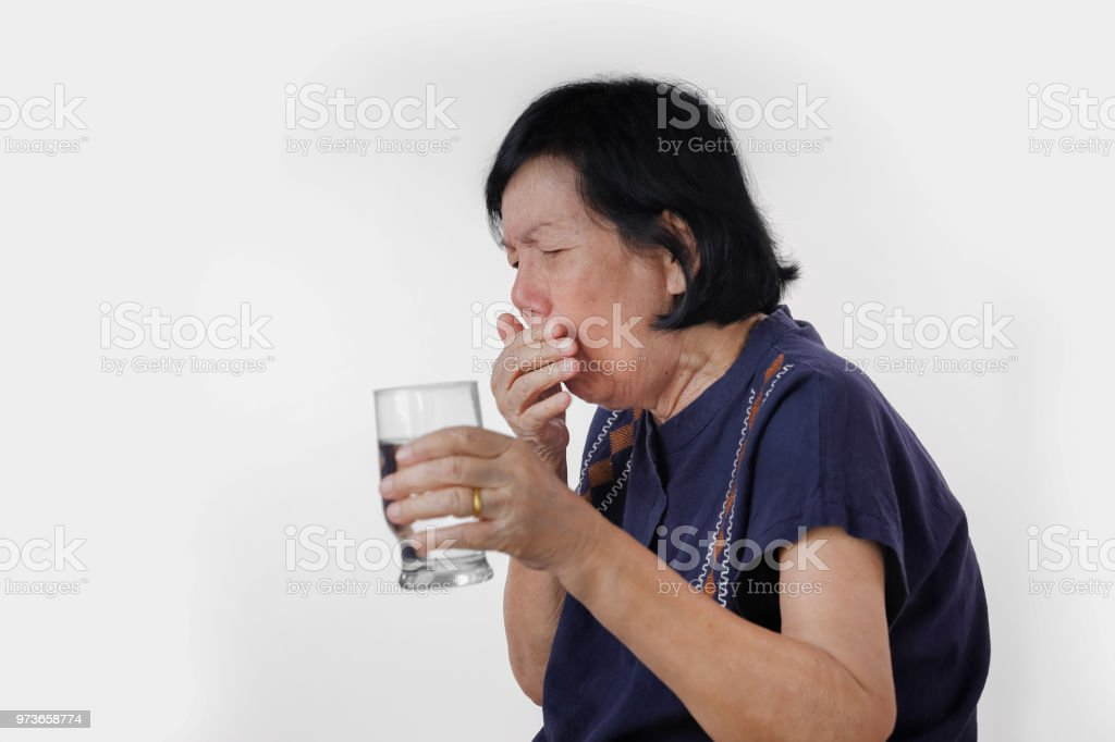 elderly woman Choking a water drink after take  medicine ,isolated on white background. stock photo