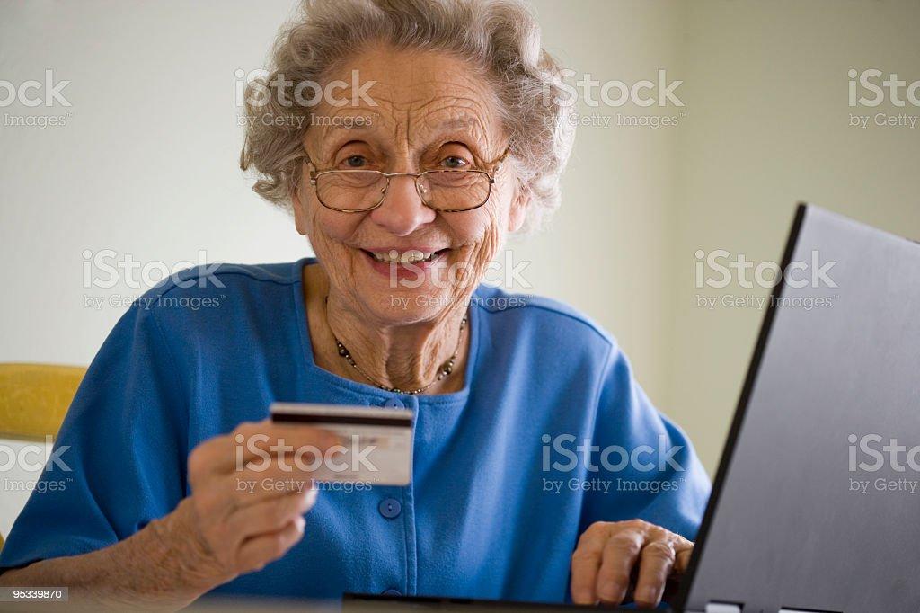 Elderly woman doing online shopping royalty-free stock photo